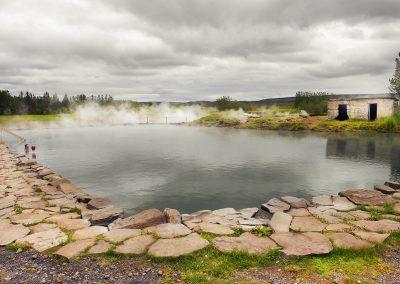 Den geotermiske badesø Secret Lagoon ved Flúdir
